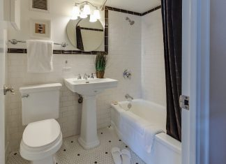 Inside the bathroom is a bathtub, lavatory, mirror towel, cabinets, bowl and the best shower curtain