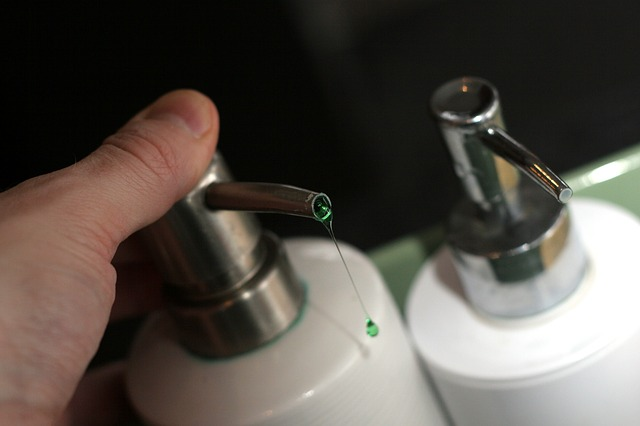 liquid soap dripping from a bottle with nozzle